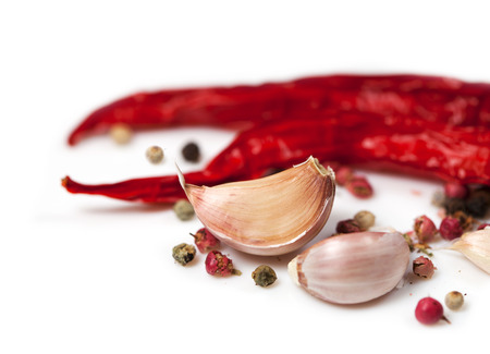 Food  ingredients - garlic and pepper  isolated over white background photo