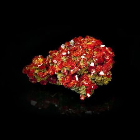 Texture of nature - gem  red crystal Garnet  on black background photo