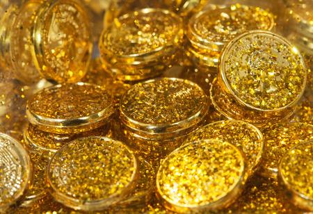 Golden texture, golden coins and gol sand background