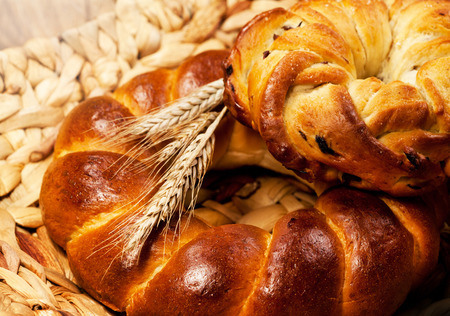 traditional goods: Fresh baked traditional bread with wheat on wooden table    Stock Photo
