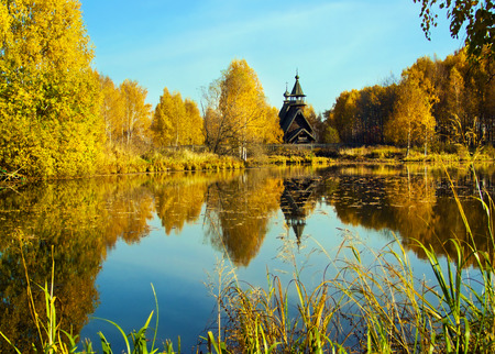 curch: Autumnal nature, beautiful scenery. Forest, curch and river Stock Photo