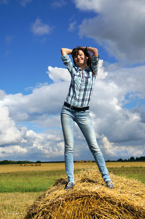 fortunate: Autumnal nature; Happy woman in haystacks on fields