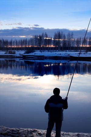 Fishing on Volga canal , Kostromskya region, sunset photo