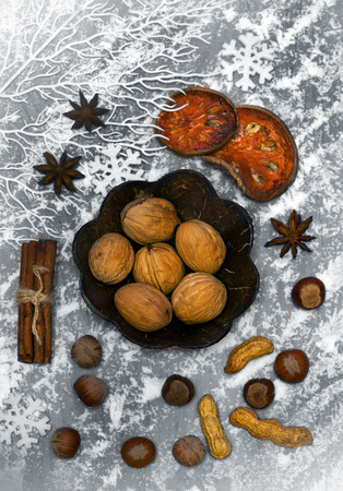 spicery: Christmas spicery, nuts and decorations with snow Stock Photo