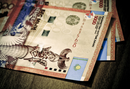 Money of Kazakhstan, large denominations for a wooden table photo