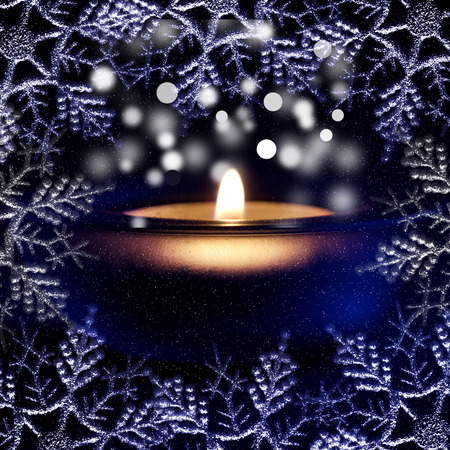 Christmas light, candle and frosty pattern photo