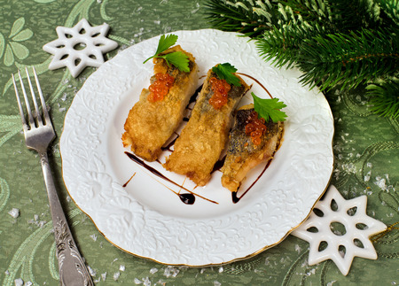 holiday food: Tasty food roasted fish on a holiday and Christmas decor Stock Photo