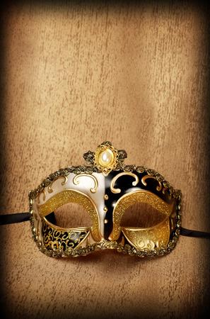 venice mask: Venetian golden carnaval mask on golden satin
