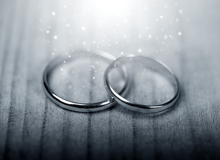 wedding band: Wedding golden rings on old wooden background Stock Photo