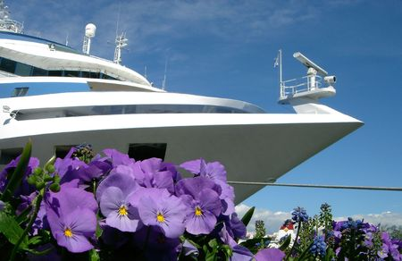 White ship and lilac flowers photo