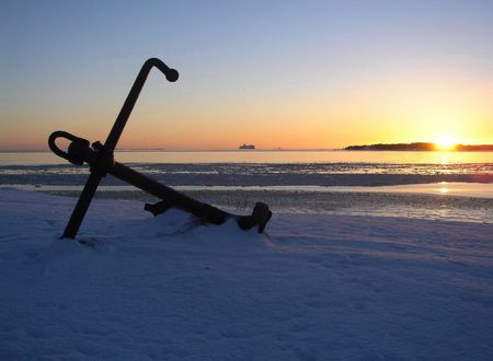 The lost anchor on a snow, on a sunset
