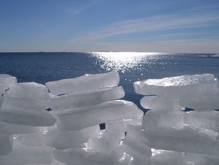 Ice fortress on a background of the dark blue sea photo