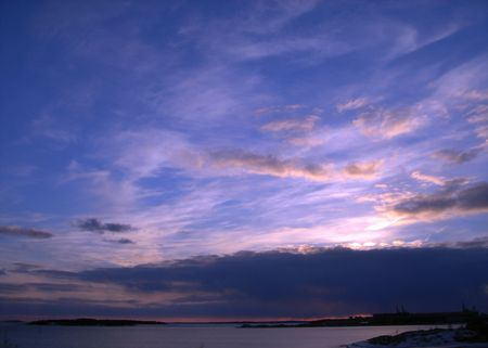 Sea sunset. Blue sky and pink clouds