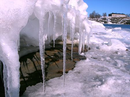 Spring icicles on a background of the dark blue sky photo