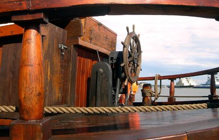 Wooden rudder and deck of the old ship
