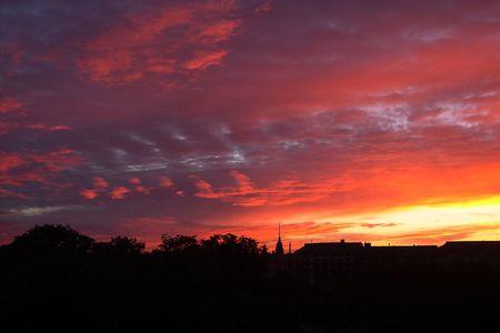 Sunset above city Helsinki Stock Photo