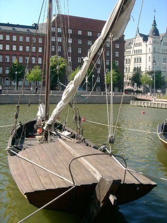 Ancient wooden boat in city Helsinki photo
