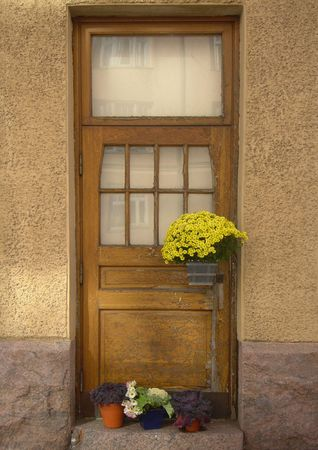 frontage: Door of an old European house and flowers
