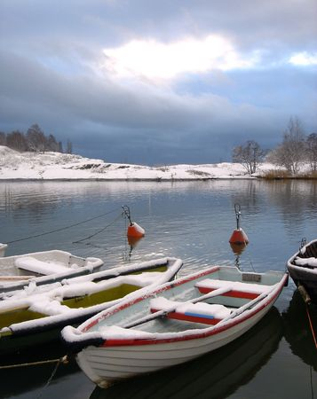 Fishing boats under snow in the Finnish gulf      photo