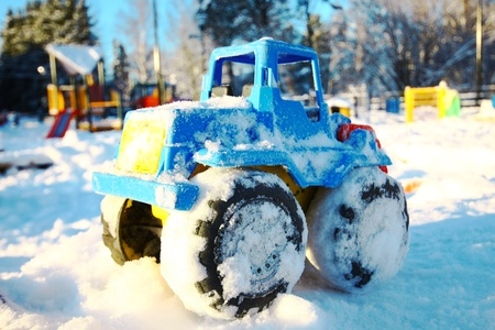 Toy vehicle in snow photo