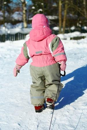 Child Pulling sledges photo