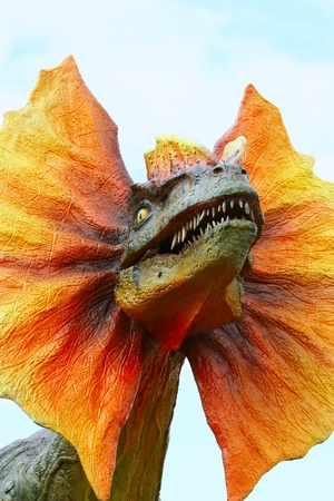 ancient creature: Dilophosaurus dinosaur with orange collar