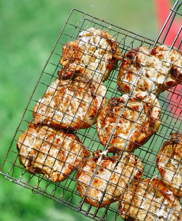 Steaks in Barbecue grill photo