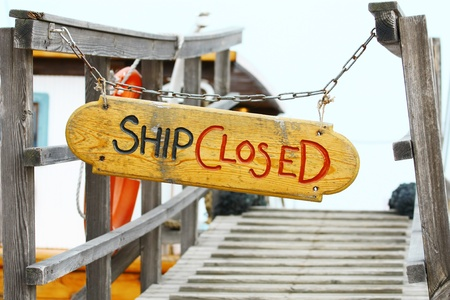 Old wood notice boardShip closed photo