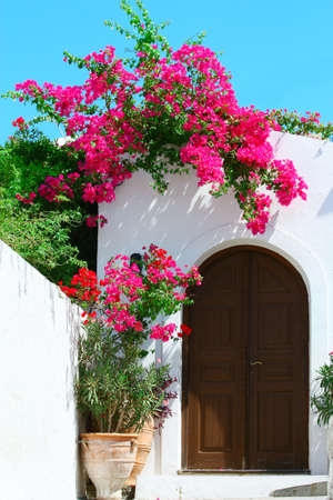 mediterranean houses: Door in Lindos - island Rhodes, Greece  Stock Photo