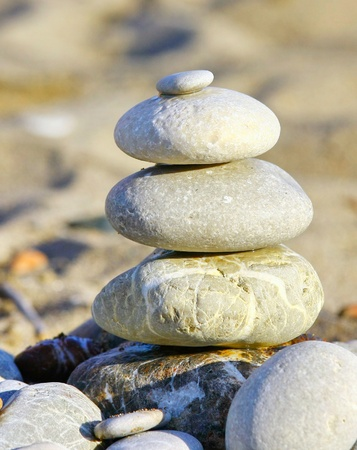Stack of stones on the beach photo