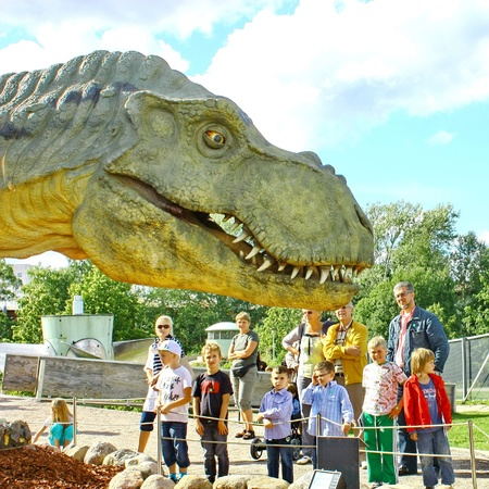 Vantaa, FINLAND - AUGUST 10: People look at Dinosaur exhibition in Finnish Science Centre Heureka on August 10, 2011 in Vantaa. Designed and produced by Rafael Estevez with Mexican Museo del Desierto Editorial