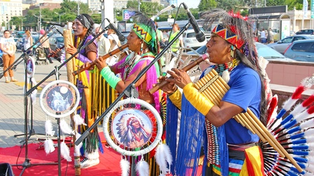 panpipe: MOSCOW, RUSSIA - JUNE 1: Native American Indian tribal group play music and sing in the street for tourists and city dwellers on June 1, 2013 in Moscow, Russia  Editorial