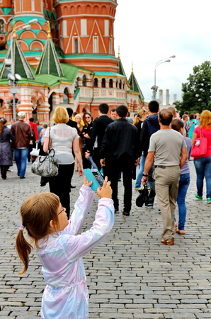 MOSCOW - JULY 20: Tourists visiting the Red Square on july 20, 2013 in Moscow, Russia. The Red Square and the Kremlin are the main attractions in Moscow