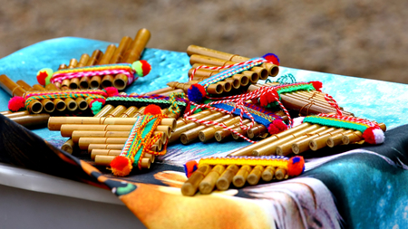 Native American colorful Andean flutes on artisan traditional product market   Stock Photo