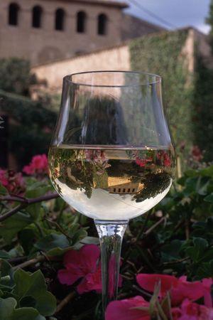 casks: A glass of Chardonnay sits on a wine cask
