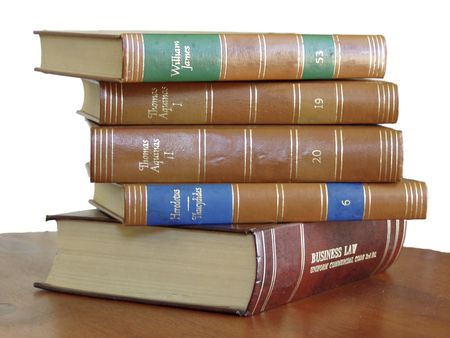 tomes: Stack of Textbooks sits on wooden desk