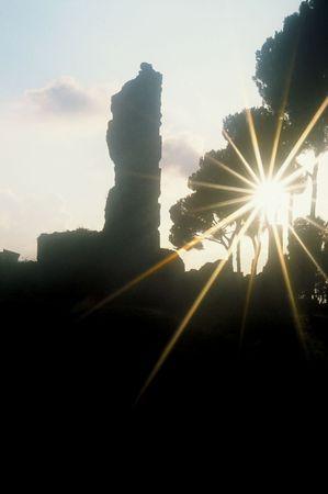 gleams: Sun in star gleams over monolithic ruin in Europe