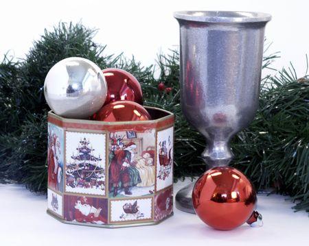 pewter mug: Christmas decor with tin, ornaments, garland & chalice Stock Photo