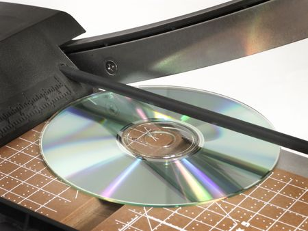 CD on cutting edge of chopper gives new meaning to cutting a CD. photo