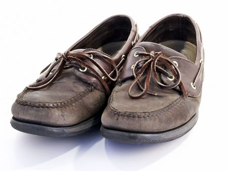 threadbare: Pair of old worn brown leather boat shoes. Stock Photo