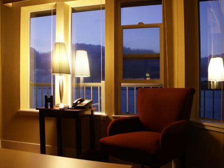 Soft dusk light shows purple hills out windows of boutique hotel. photo