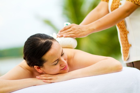 An attractive young woman lying on a massage bed at a spa outdoors Stock Photo - 9804483