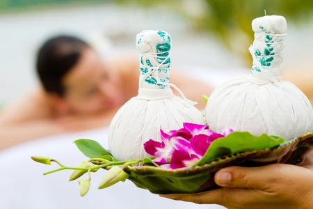 An attractive young woman lying on a massage bed at a spa outdoors Stock Photo - 9804481