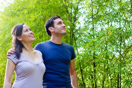An attractive young couple relaxing outdoors together Stock Photo - 9804495