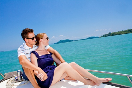 An attractive young couple relaxing outdoors together on a boat Stock Photo - 9804494