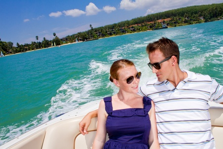 An attractive young couple relaxing outdoors together on a boat Stock Photo - 9804493