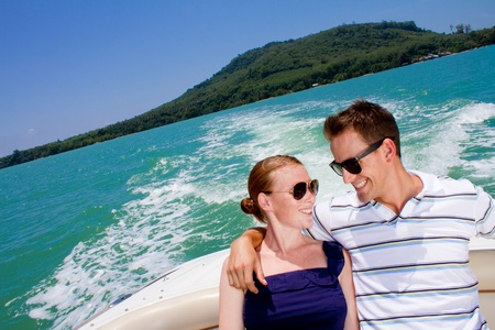 An attractive young couple relaxing outdoors together on a boat Stock Photo - 9919167