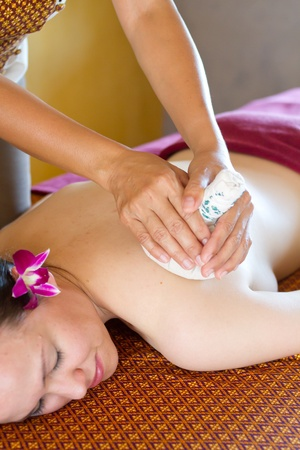 An attractive young woman lying on a massage bed at a spa indoors Stock Photo - 9919169