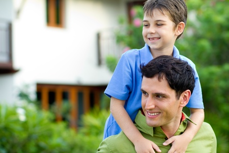 Father giving his son a piggyback ride Stock Photo - 9919186