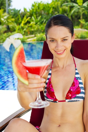 A young and attractive woman with drinks outdoor Stock Photo - 10307128